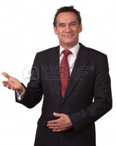 9494707-attractive-middle-age-business-man-in-suit-smiling-welcome